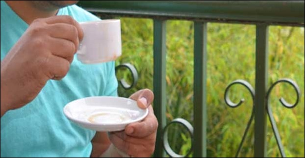Sipping a cup of tea in the morning from Hotel Tanency's Balcony