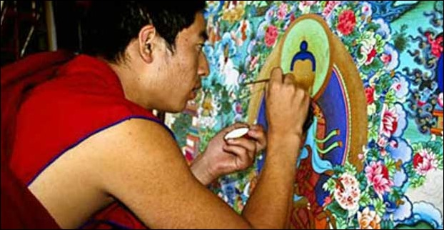 An artist making scroll painting