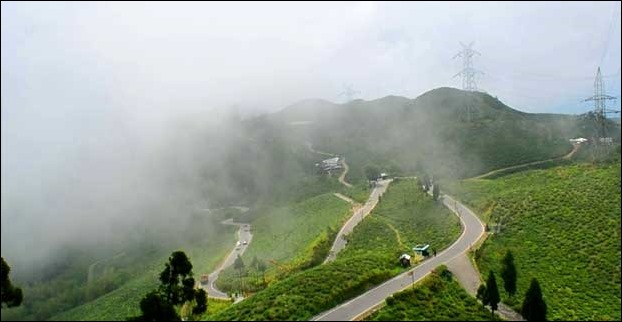 The zizgag roads wrapped in fog at the Tingling View point on Darjeeling via Mirik route