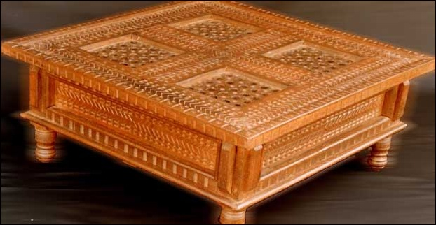 A beatifully carved himachali table